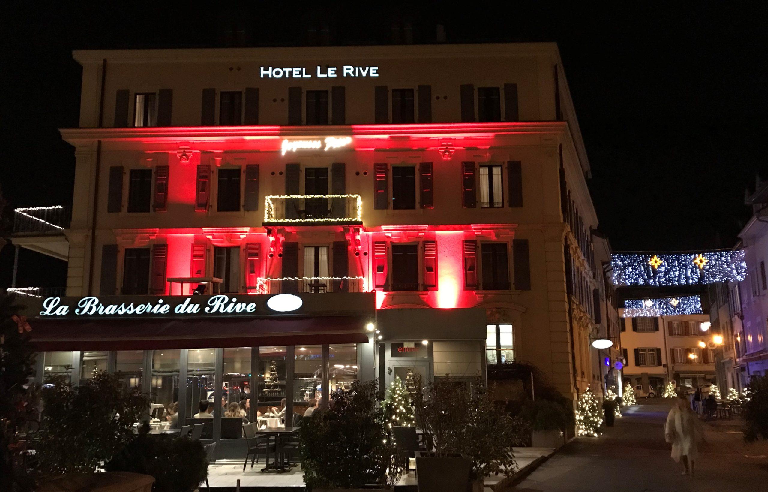 Façade en rouge de l'hôtel de Rive